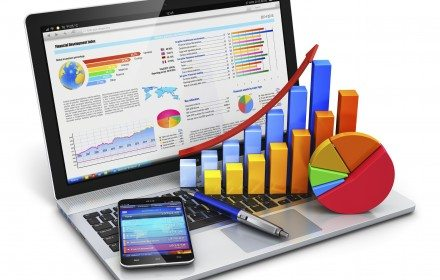 Creative abstract mobile office, stock exchange market trading, statistics accounting, financial development and banking business concept: modern laptop or notebook computer PC with stock market application software, growth bar chart, pie diagram, ballpoint pen and touchscreen smartphone isolated on white background