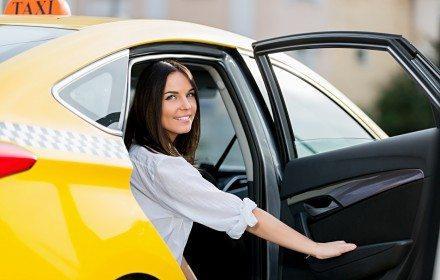 Beautiful girl in a taxi