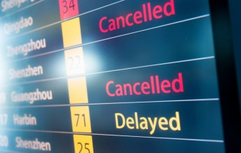 Detailed flight information board showing the flights delayed.