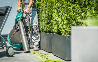 Leaf Blower Garden Vacuum in Hands of Professional Gardener