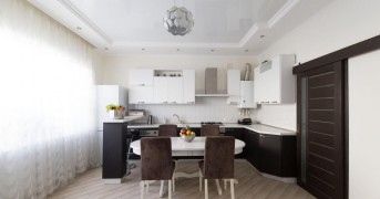 Beautiful interior apartment kitchen. Modern style. Design background. Home decoration. Nature materials. White, brown, beige color. Ceramic tile floor view. Fashion luxury room.