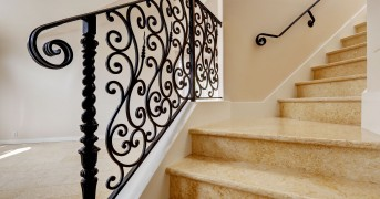 31999716 - emtpy house interior with shiny tile floor. marble staircase with black wrought iron railing