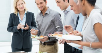Business Colleagues Eating Meal Together In Restaurant